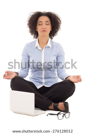 happy beautiful african american business woman sitting in yoga pose with laptop isolated on white background - stock photo