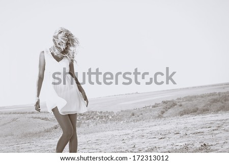 Happy beautiful and sexy young blond woman in black and white - stock photo