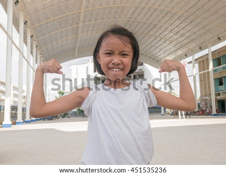 Happy Beautiful asian kids  with drawn muscles. .