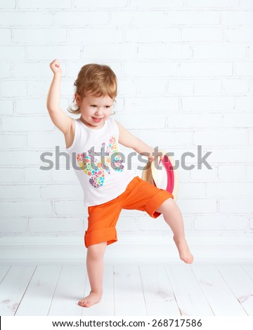 happy beautiful baby girl dancer dancing modern hip hop dance - stock photo