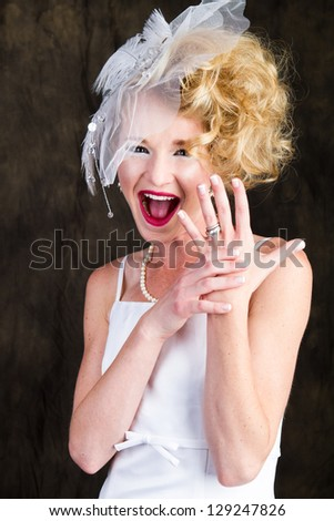 Happy Beautiful Bride showing off her ring with hands outstretched - stock photo
