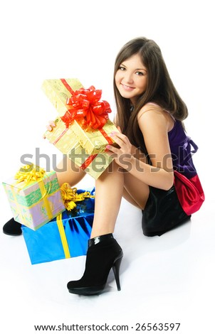 happy beautiful brunette girl on the floor with a lot of presents - stock photo