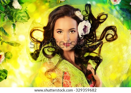 Happy beautiful brunette woman among summer plants and flowers. Beauty, fashion. Spa, healthcare. Tropical vacation. - stock photo