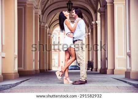 Happy beautiful couple having fun in the european city - stock photo