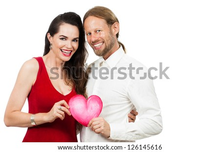 Happy beautiful couple smiling and holding a love heart. Isolated on white. - stock photo