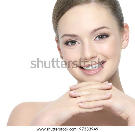 Happy beautiful face of young woman with clean skin - white background - stock photo