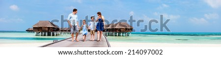 Happy beautiful family during summer vacation at luxury resort wide panorama with copy space, perfect for banners - stock photo
