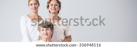 Happy beautiful family girls holding together - stock photo
