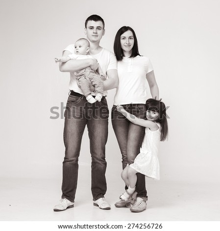 Happy beautiful family 4 people with new born baby parents sister brother portrait - stock photo