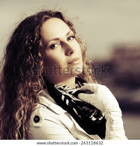 Happy beautiful fashion woman with long curly hairs outdoor - stock photo