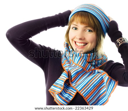 happy beautiful ginger girl wearing a hat and scarf isolated against white background - stock photo