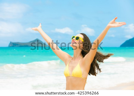 Happy beautiful girl enjoying a sunny day on the beach. (location Hawaii) - stock photo