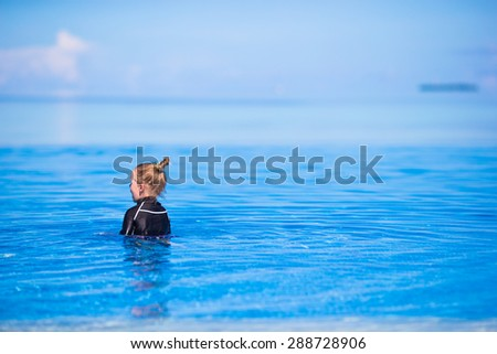 Happy beautiful girl having fun in outdoor swimming pool - stock photo