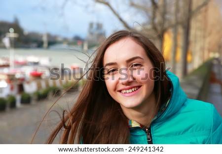 Happy beautiful girl in Paris - stock photo
