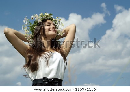 happy beautiful girl standing against the sky - stock photo