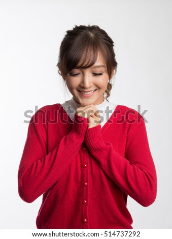 Happy beautiful girl wearing red sweater praying to god,  Christmas concepts, Winter concepts , isolated on white background