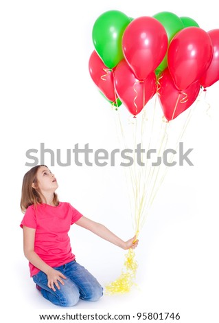 Happy beautiful girl with baloons looking up - stock photo