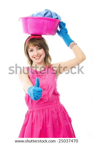 happy beautiful housewife with a basin full of clothes on her head and her thumb up