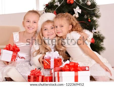 happy beautiful kids celebrating New Year at home - stock photo