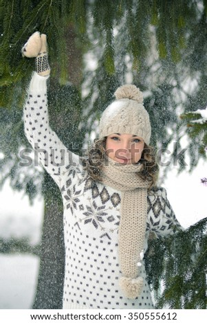Happy,beautiful,nice,attractive,smiling,delightful,little,pretty,cute,young girl,woman,child,person,adult in the white,cold,winter forest play with snow,snowflakes,smile ,wish,playful,nature,fun,joy - stock photo