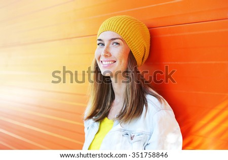 Happy beautiful smiling woman wearing a colorful clothes  - stock photo