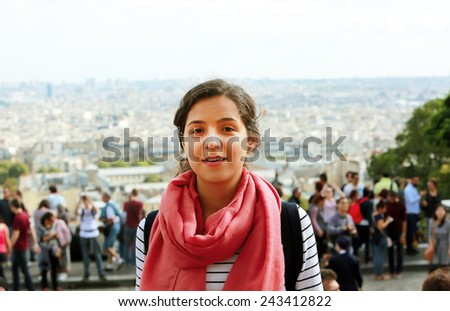 Happy beautiful student girl in the city - stock photo
