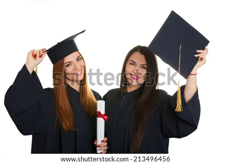 Happy beautiful two woman female graduate holding her diploma and smiling isolated over a white background - stock photo