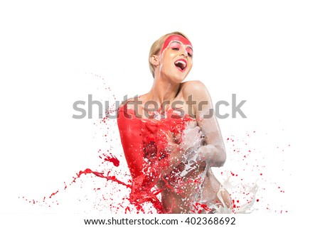 Happy beautiful woman covered colorful paint splashes isolated on light background - stock photo