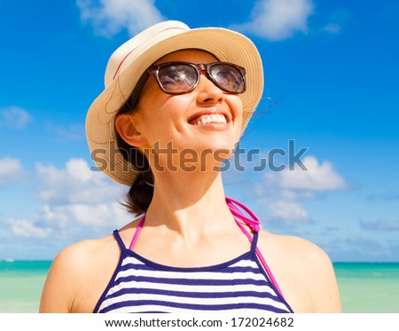 Happy beautiful woman enjoying summer vacation.