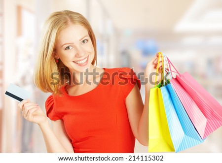 happy beautiful woman on shopping with bags and credit cards, christmas sales, discounts - stock photo