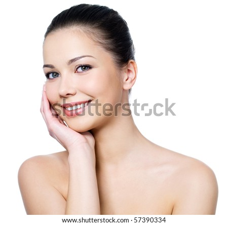 Happy beautiful woman's face with fresh clean skin - isolated on white background - stock photo