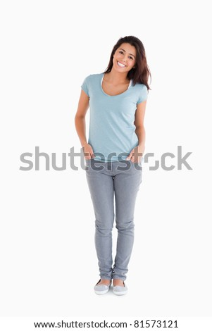 Happy beautiful woman standing against a white background - stock photo