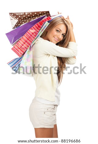 Happy beautiful  woman with colorful shopping bags in her hands