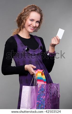 happy beautiful woman with credit card and bags
