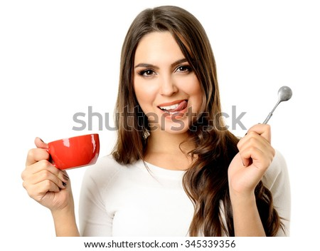 Happy beautiful woman with cup of coffee and spoon isolated on white background - stock photo
