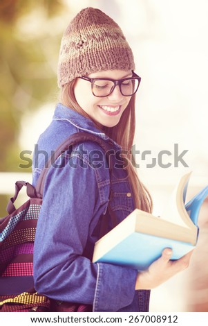 Happy beautiful young student with books - stock photo