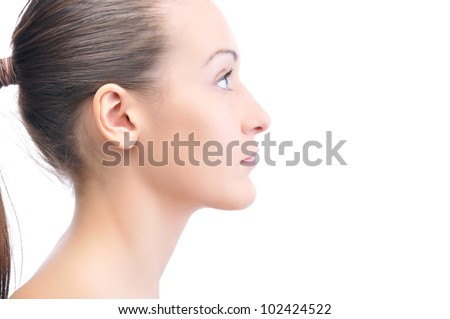 happy beautiful young woman is looking sideways isolated on white - stock photo