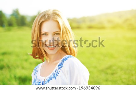 happy beautiful young woman laughing and smiling on nature in green - stock photo