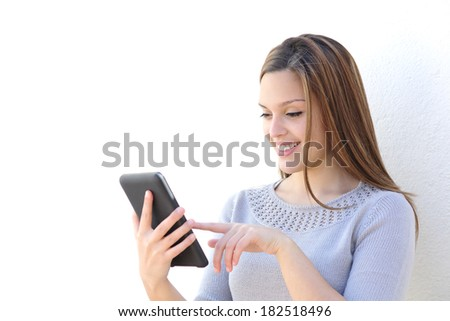Happy beauty woman texting on a tablet on a white background           - stock photo