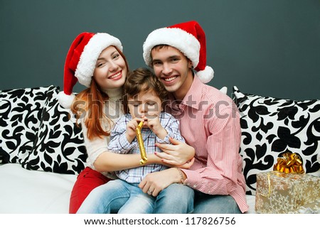 Happy Big family holding Christmas presents at home.Christmas tree - stock photo