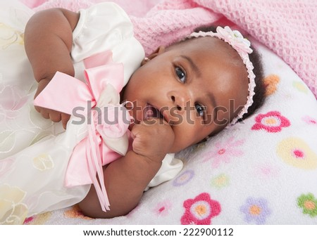 happy big smiling 6-month old African American baby girl portrait - stock photo