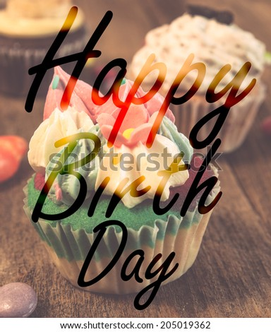 Happy birth day cupcake on wood table - stock photo