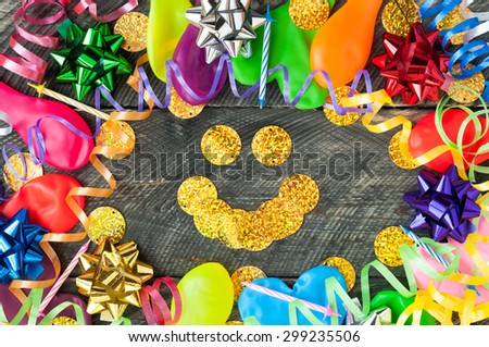 Happy birthday backgrounds. Balloons, streamers, ribbons, bows, candles and smile on wooden table - stock photo