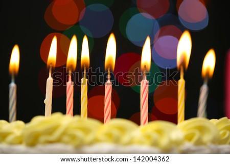 Happy birthday cake, on black background - stock photo