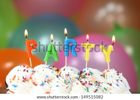 Happy Birthday Celebration with Balloons Candles and Cake