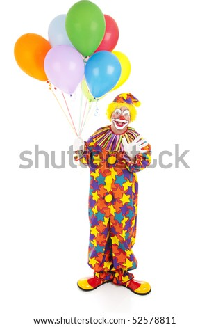 Happy birthday clown holding a bunch of balloons.  Full body isolated - stock photo