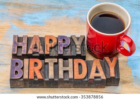 Happy Birthday greeting card - text in vintage letterpress wood type with a cup of coffee - stock photo