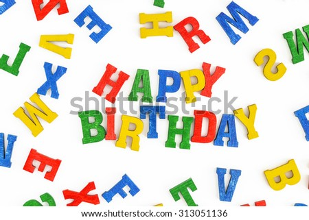 Happy Birthday in wooden letters on white background