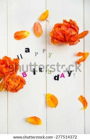 Happy Birthday Letters Cut out from Magazine and Orange Tulip