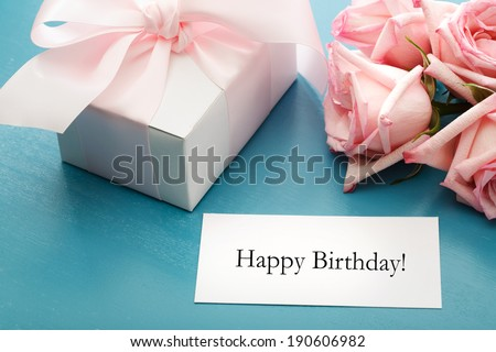 Happy Birthday message card with gift box and pink roses - stock photo